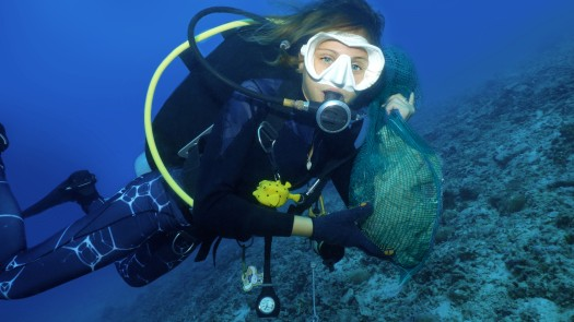 Chiara collecting trash underwater